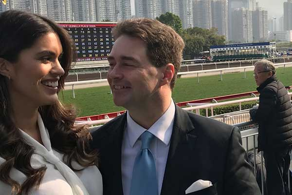 Carsten Pfau with Ariela Machado at the horse racing track in Hong Kong